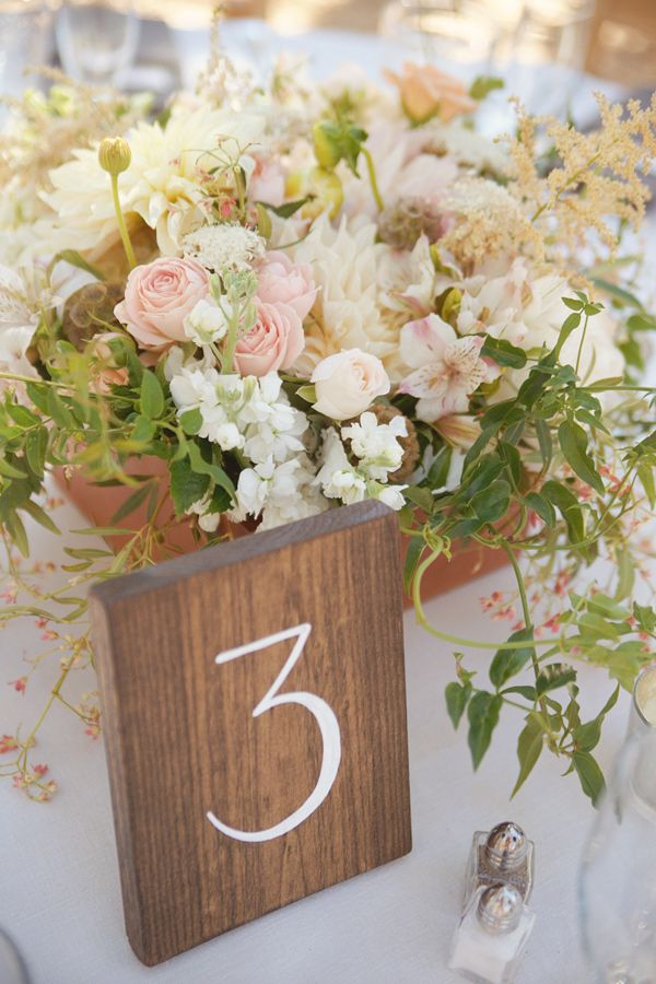 table numbers on wooden blocks, photo by Emily Heizer http://ruffledblog.com/woodsy-sierra-nevada-wedding #tablenumbers #weddingideas