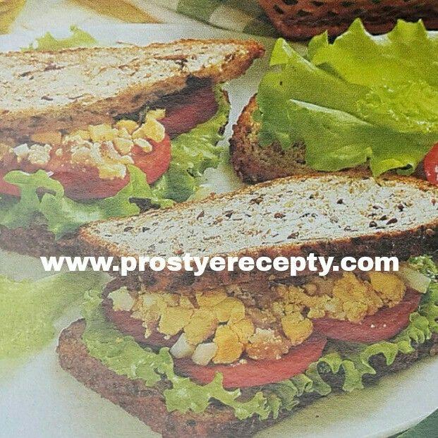 БУТЕРБРОДЫ С САЛАТОМ ИЗ ЯИЦ.  На 4 порции : 8 ломтиков зернового хлеба, 3яйца, 60г филе анчоусов ( или кильки пряного посола ), 1 ст.л оливкового масла, 1 помидор, 8листиков зеленого салата.  НА САЙТЕ ЕЩЕ БОЛЬШЕ РЕЦЕПТОВ.  #рецептыблюд #кулинария #закуски #едимдома #рецептырулетов #простыерецепты #вкуснаяеда #еда #готовитьпросто #готовимдома #вкусныерецепты #завтрак #закуски