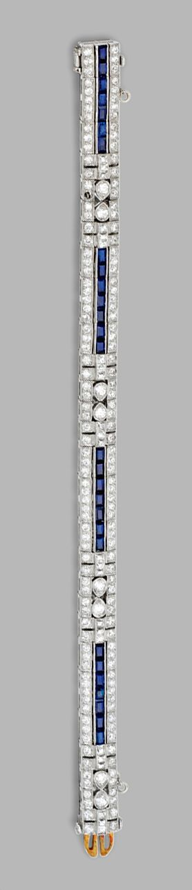 PLATINUM, DIAMOND AND SAPPHIRE BRACELET, TIFFANY  CO., CIRCA 1925.  Set with old European-cut and French-cut diamonds weighing approximately 6.40 carats, accented by calibré-cut sapphires, length 6 3/8  inches, signed Tiffany  Co.