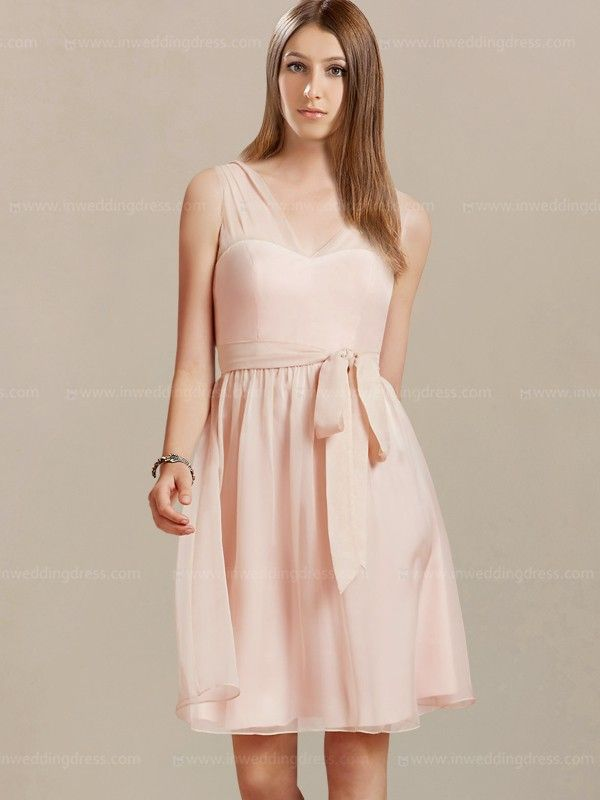 You will love this beach destination bridesmaid dress because of its clean, sophisticated style and beautiful color options. Features of this eye-catching dress include a short pleated skirt as well as V shape neckline and back. Short bridesmaid dresses are perfect for any type of wedding celebration and this design is no exception. Available in 60 colors, shown in Pink.