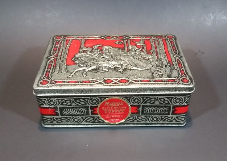 1950s Riley's Rum & Butter Toffee Medieval Hunting Scene Embossed Red Tin with Original Sticker https://treasurevalleyantiques.com/products/1950s-rileys-rum-butter-toffee-medieval-hunting-scene-embossed-red-tin-with-original-sticker #Vintage #VintageTins #1950s #50s #RileyBrothers #Toffee #Candy #Candies #Sweets #Tins #Medieval #Hunting #Scenery #Embossed #Rum #Butter #Collectibles #Decor