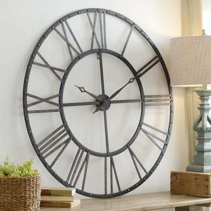 Decorate a blank wall in your home with this stylish and large Addison Open Face Clock!