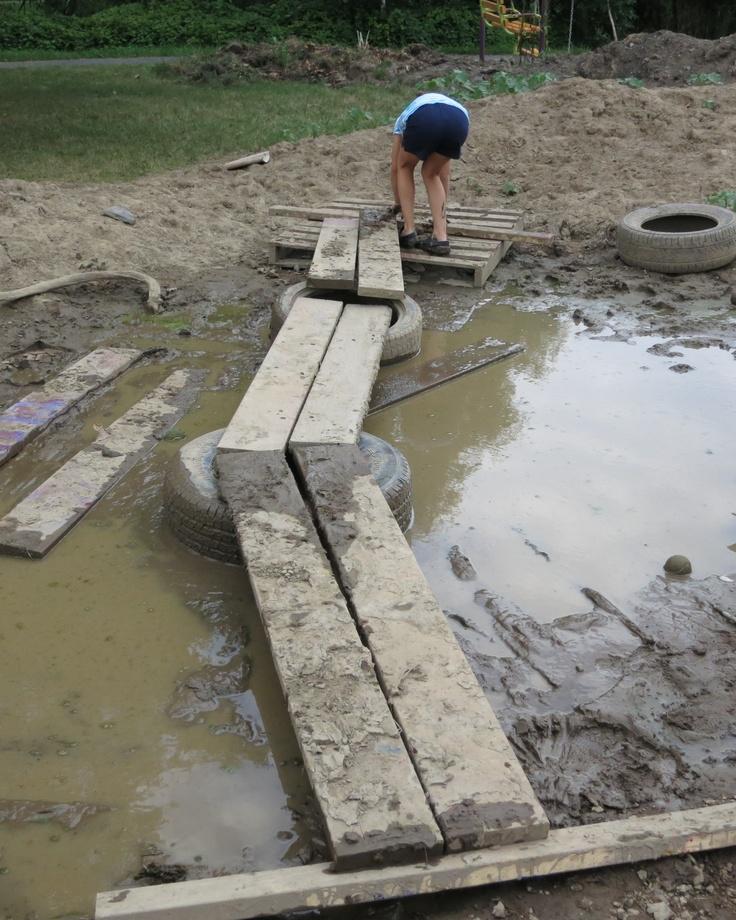 large, shallow puddle -- being bridged (Ithaca Children's Garden)