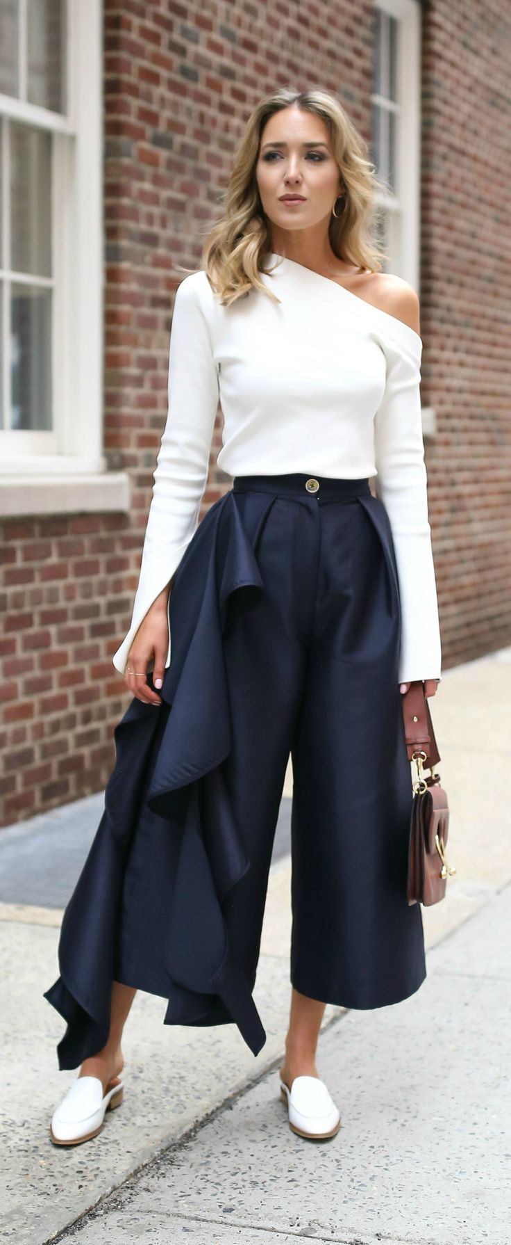 ivory one shoulder long sleeve top, navy culottes with ruffles down leg, white mules slides, brown pierce bag {solace london, net-a-porter, everlane, j.w. anderson} In all love love this style