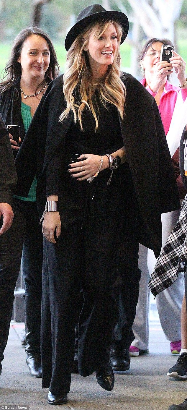Style star: Delta Goodrem continues her statement outfits run with head-to-toe black ensemble at Knox Shopping Centre on Thursday
