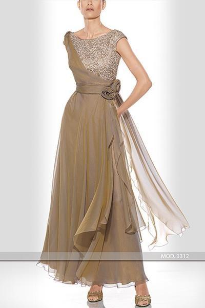 Consultar precio o pedir una cita Vestido de madrinade la diseñadora Teresa Ripoll modelo 3312 realizado en gasa de seda con cuerpo de pedrería.Se puede realizar en varias tonalidades. Al ser un vestido de alta costura se realiza a medida.