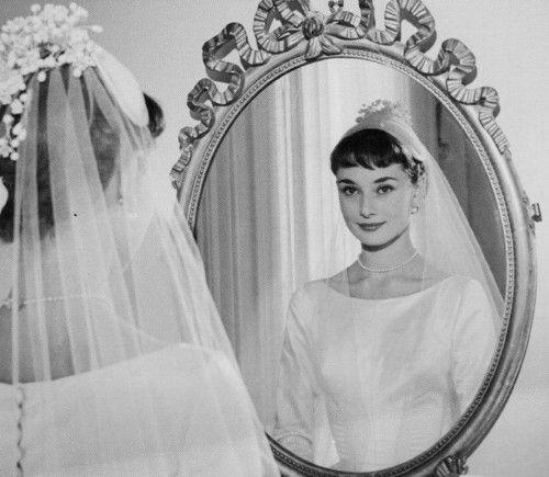 Audrey Hepburn in the wedding dress she famously gave away to a poverty stricken young Italian girl.   http://fineestateliquidation.com/audrey-hepburns-wedding-dress/
