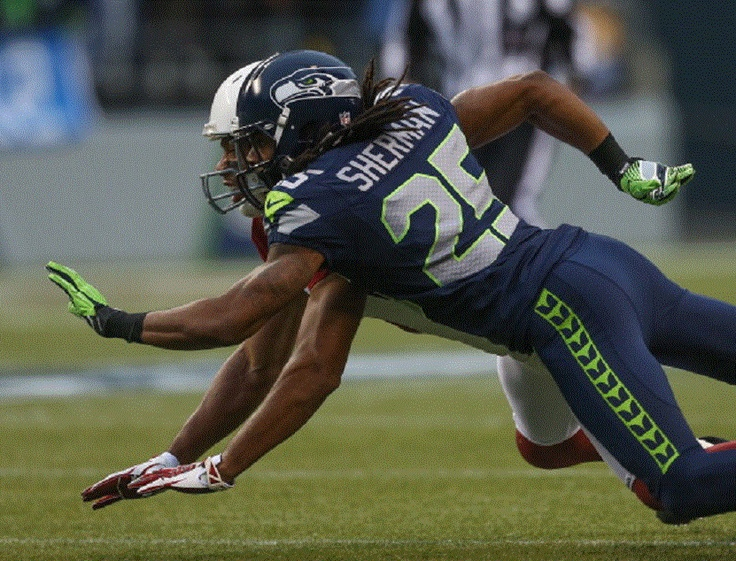 Cornerback Richard Sherman #25 of the Seattle Seahawks defends on a pass intended for wide receiver Larry Fitzgerald #11 of the Arizona Cardinals
