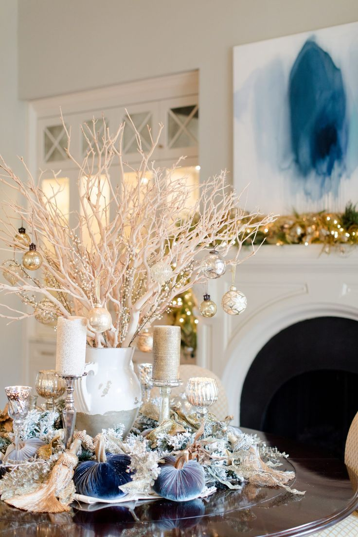 Gold and blue Christmas decorations. Plush Pumpkin velvet pumpkins below manzanita branches with Christmas ornaments hanging from them.