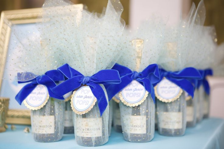 Custom wrapped mini champagne bottle favors by Lovelyfest. Fun favors that all guests will enjoy! | Lovelyfest Event Design | Royal Blue Baby Shower