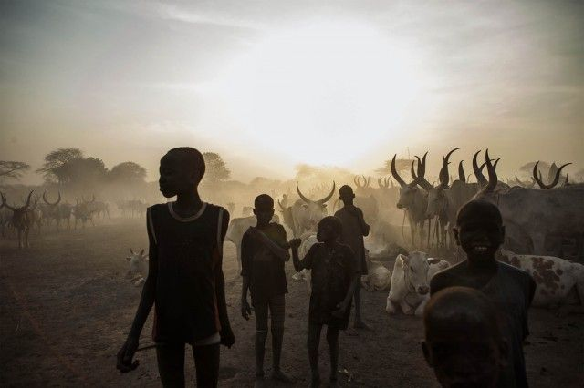 south sudanese children from the dinka ethnic group pose at cattle camp in the town of yirol - by fabio bucciarelli / afp