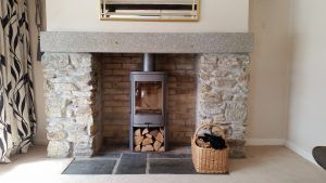 The bricks were cleaned with brick acid, the new granite mantle fitted and the stove fitted