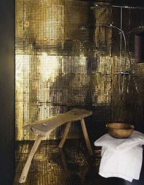 shower room - gold tiles , handmade wood stool
