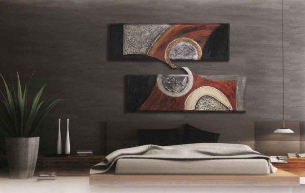 Camera con grandi quadri - I quadri sono perfetti per arredare e personalizzare la camera da letto.
