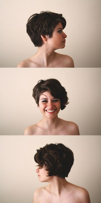 Adorable short hair. Love the asymmetry with the curl on one side.