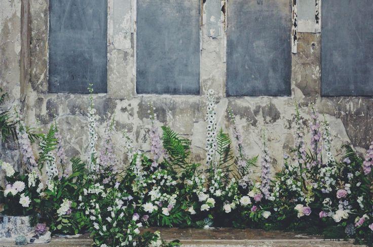 Flowers by Kent florist Jennifer Pinder a wedding hedgerow arrangement at the Asylum in Peckham London