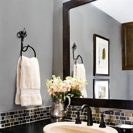 If the budget allows, mosaics are the ideal solution to introduce colour to the bathroom. There are a wide variety of colours and textures to choose from. http://www.easydiy.co.za/index.php/improve/544-guest-bathroom-facelift