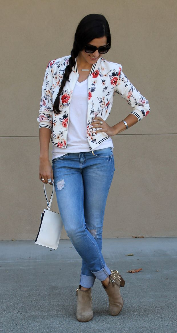 Especially the striped accents mixed with the floral. Fun twist to a traditional bomber jacket.