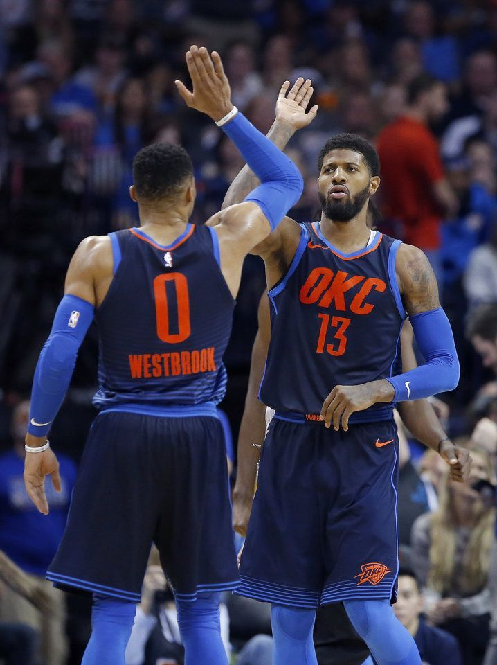 Oklahoma City s Russell Westbrook (0) and Paul George (13) celebrate during  the NBA basketball game between the Philadelphia 76ers and Oklahoma City  Thunder ... b258814db