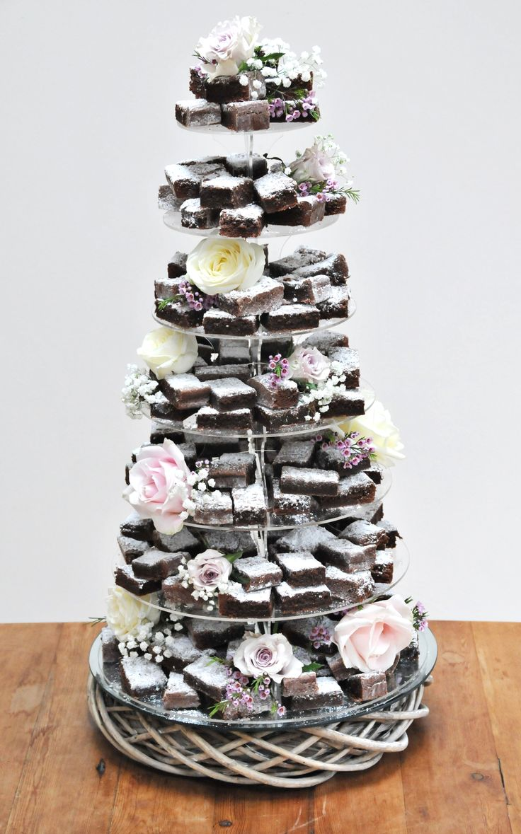 Wicker base, 7 tier, 192 brownies. It will get eaten. This could also be an option at the dessert table