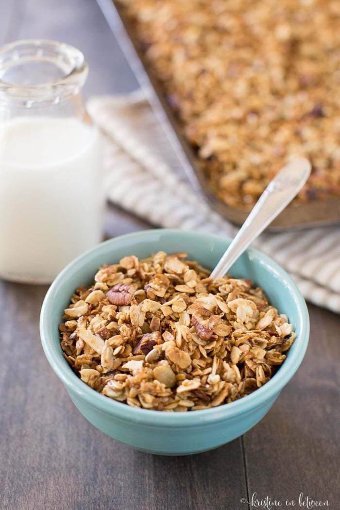 Perfectly sweet and crunchy everyday granola with on refined sugar! It's made with oats, pumpkin seeds, pecans, almonds, honey and maple syrup!