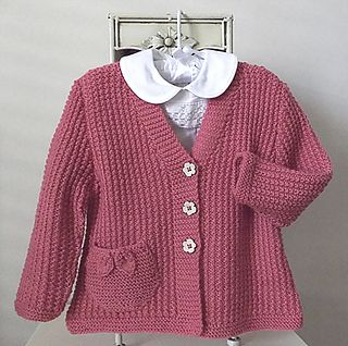 This sweet little girls V neck cardigan is great for the knitter who has mastered the art of knit and purl. The textured effect looks complicated, however is very easily achieved. The pocket/s with delicate leaves, adds that special bit of detailing.