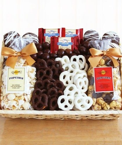 Crunch Time Sweet Snacks-It's always crunch time with this great gift filled with everyone's favorites. Who can resist two types of gourmet popcorn, white and milk chocolate-covered pretzels, chocolate-covered sandwich cookies and Ghirardelli chocolate squares? No one! This great gift comes packed in a natural woven basket. #CityLineFlorist #TrumbullFlowers #AdministrativeProfessionalsWeek