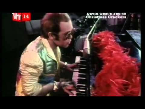 Elton John. Step Into Christmas | Official Video | From an age when Christmas songs were more than just novelty throwaways, this 1973 effort was recorded in the Goodbye, Yellow Brick Road era, and duly borrowed some of that album's glam-rock stomp and irresistible melody. Itself recorded in part as a homage to the classic Phil Spector-produced Christmas songs of the Sixties