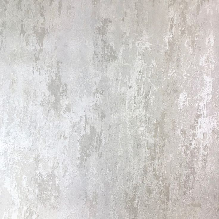 Rough Plaster wallpaper 32651-4. Easily create a modern industrial feel to any room with this multi tonal cream and grey rough plaster design with a light catching sheen.