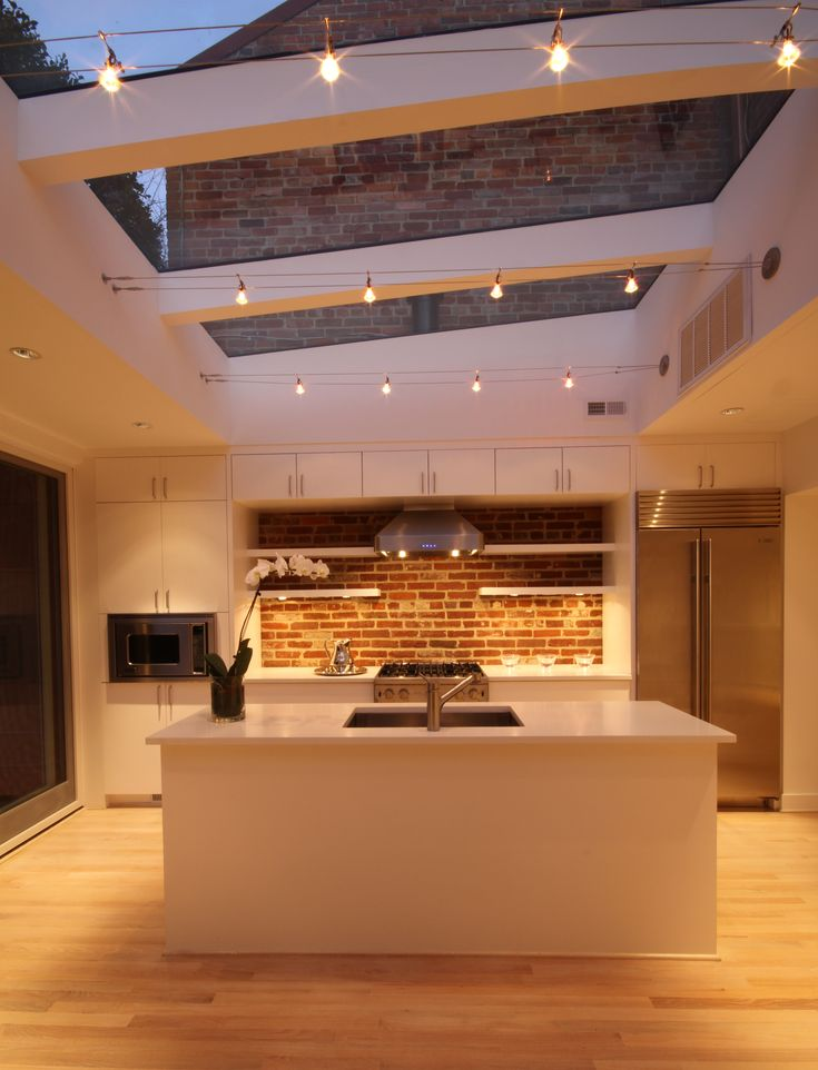 Kitchen #skylight #kitchenisland #exposedbrick Photo Credit Dennis Hornick Beautiful lighting