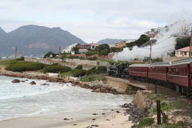 Passing the coast on Atlantic Rail. A 1930's steam train to Simon's Town, South…