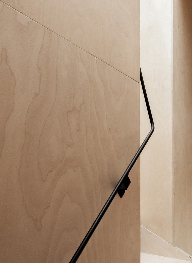 Black detailing with plywood surfaces. Hardware, fixings, accents images, graphics in dark colours navy or black.
