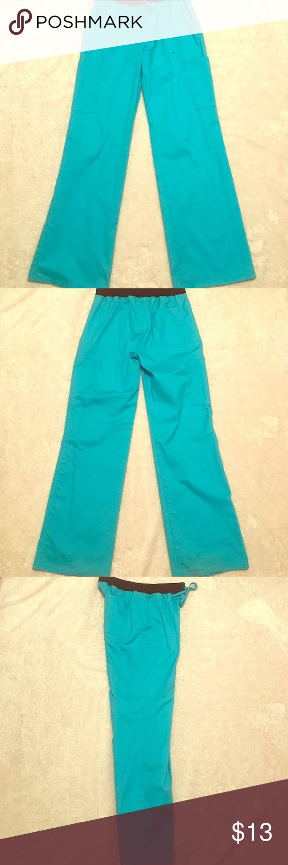 XS Teal Scrub Pants Worn a few times, still has vibrant color! There is a small, black stain (shown in last picture) but scrub tops covered it for most part. Size X-Small fits more like a Small. Pants