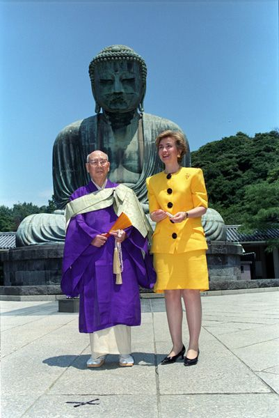 Photograph of First Lady Hillary Rodham Clinton and an Unidentified Man Standing in Front of The Great Buddha in Kamakura, Japan, 07/08/1993
