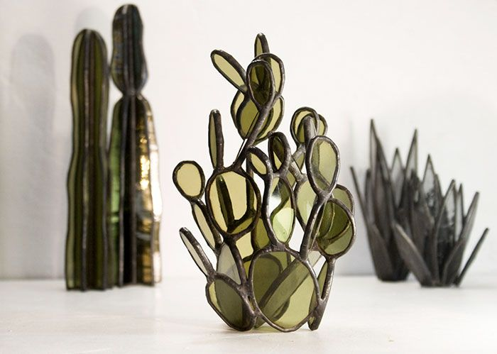 Lesley Green is a Brooklyn-based artist who pushes the limits of stained glass and glass tile art. Her projects are heavily influenced by nature and architecture, so this cactus series is one of the best examples of her magnificent work.