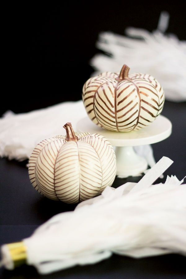 Pumpkin Decorations: White and gold bridal shower decor is very popular right now. Take this trend and give it an autumnal spin by using white mini pumpkins as your canvas for gold herringbone patterns.