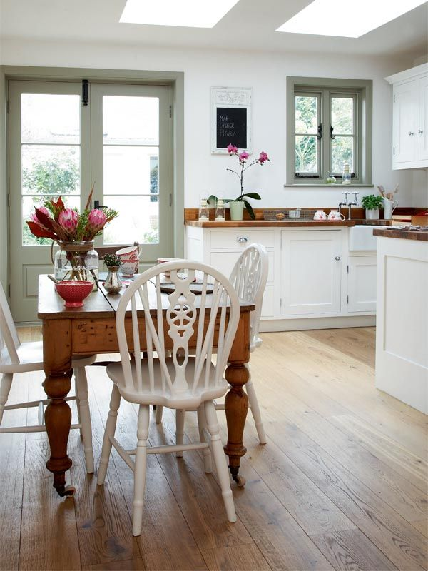 I like the joinery being a different colour here.  The lovely table and countertops warm the design up.