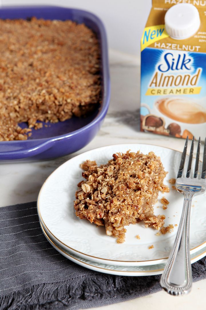 Hazelnut and Pecan Baked Oatmeal is a delicious dairy-free and gluten-free breakfast! The oatmeal, made with Silk® Hazelnut Almond Creamer, is elevated with a streusel topping. This dish is perfect as a weekday or weekend breakfast treat!