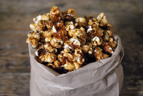 Pumpkin Pie Popcorn -10 c popped popcorn, salted. 1 c packed br sugar, 1/4 c lt corn syrup, 6 tbl butter. 1/2 tsp salt, 1/2 tsp baking soda, 1 1/2 tsp pumpkin pie spice, Preheat oven 250°F. Line a rimmed baking sheet with parchment paper. Coat lg mixing bowl w/nonstick cooking spray, dump popcorn into bowl, cept  discard unpopped kernels.In medium saucepan, whisk together brown sugar, corn syrup, butter, salt, and 2 tablespoons of water.