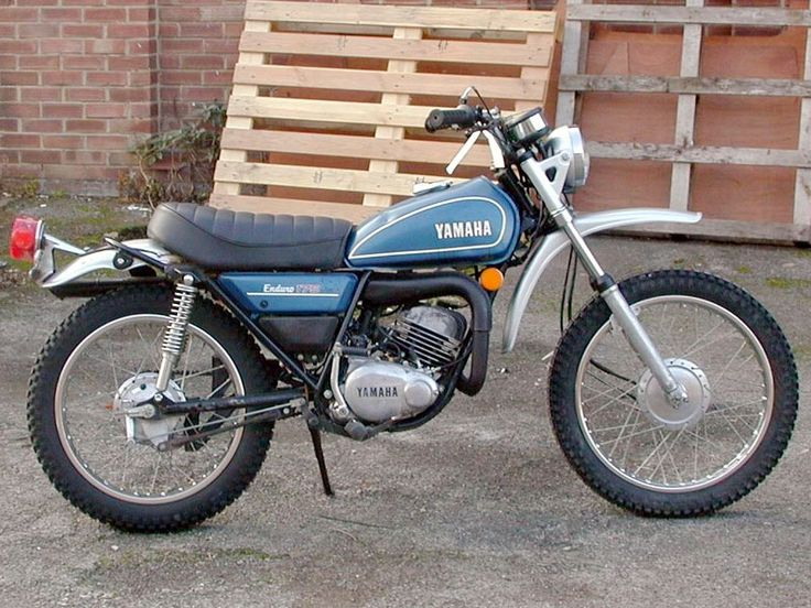 1974 Yamaha DT175.  The first off-road motorcycle I owned.  I was so small and the bike so big that I had to stand on the footpegs with the kickstand down to start it.  If it fell over on a side hill, I could not lift it up by myself I was so small.