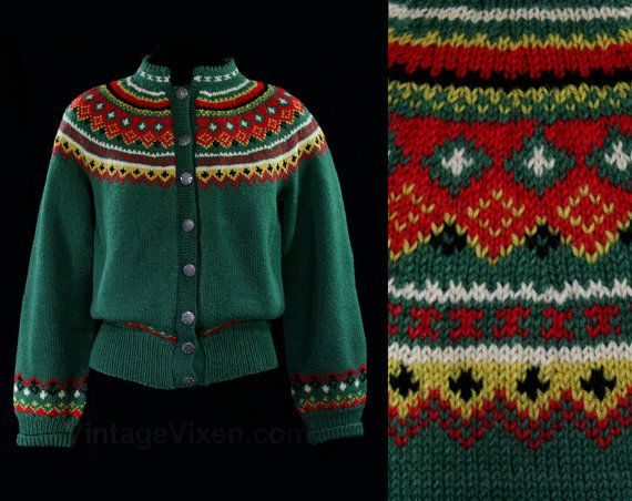 The colors in this hand-knitted cardigan are just delectable, skillfully patterned in Fair Isle inspired geometrics that grace the shoulders, forearms and waist in a wonderful Norwegian style. Has a short standing collar with scalloped rim, ribbed edges, and pewter snowflake buttons to close the front. A terrific find from Old Scandinavia, made in the 1940s to early 1950s. Ladies Size 13 to 14 Measurements Bust 40, Waist 31 to 34; Neck to Hem 20.25 Inches Era 1950s Label Husfliden / ...