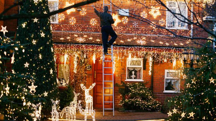 Hope this guy is careful with that ladder! This is a home in Stourbridge, England. Beautiful display!