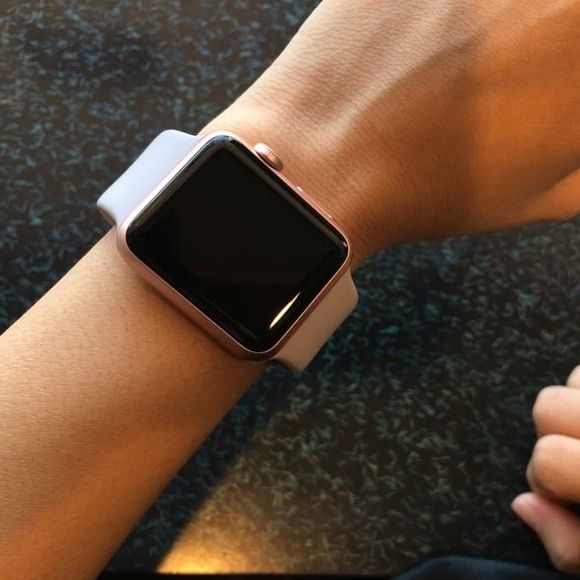 Apple Watch 38mm Rose Gold Apple Watch. Fairly new, flawless. Box and charger included. Apple ...