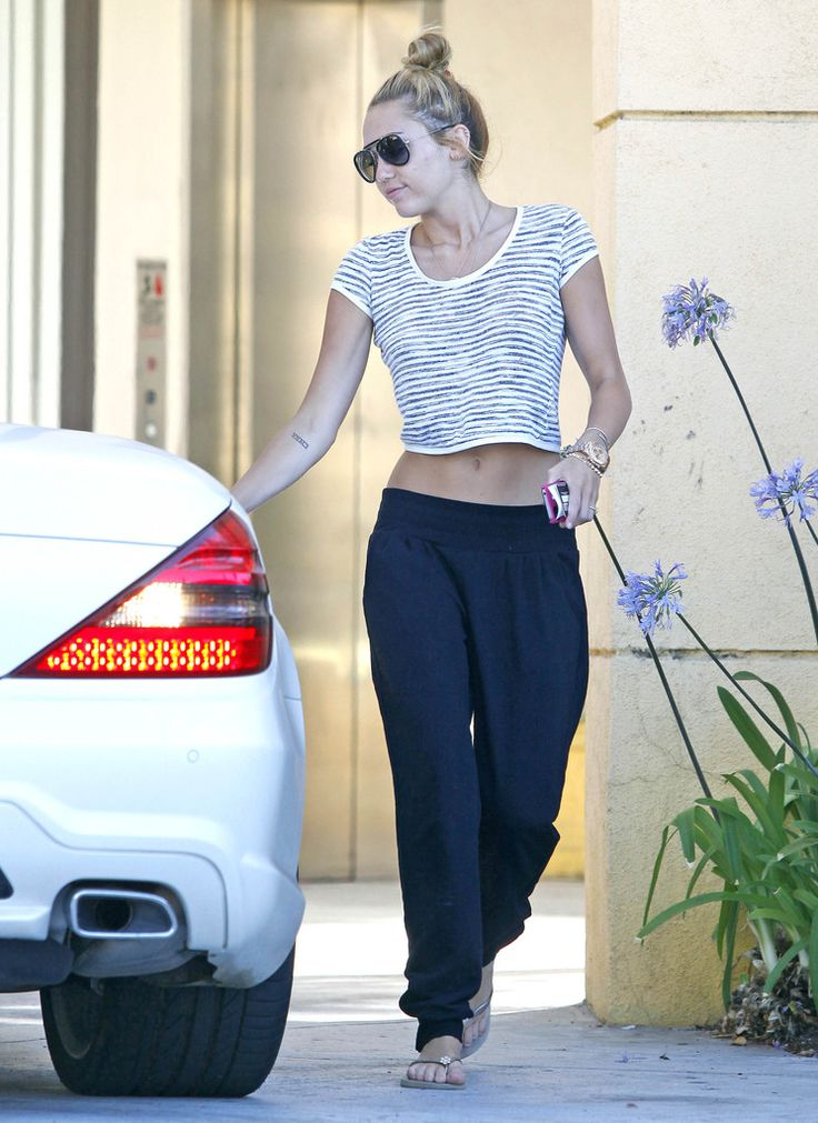 Singer Miley Cyrus stops by an office building for a minute while her pal kept the car running in Los Angeles, California on June 29, 2012.   (June 29, 2012 - Source: FameFlynet Pictures)