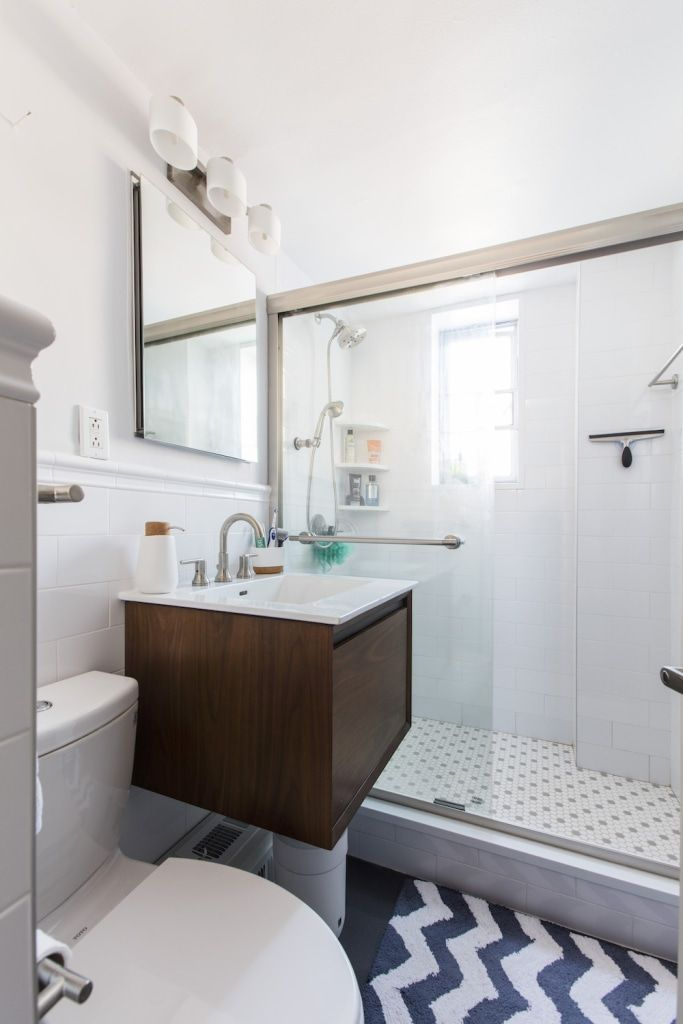 As a first-time renovator, Matt wanted to give his crumbling bath a professional makeover. To make it investment-ready, he installed new fixtures, glossy white subway tile, and a floating wood vanity. He also replaced the old tub with a sparkling walk-in shower.