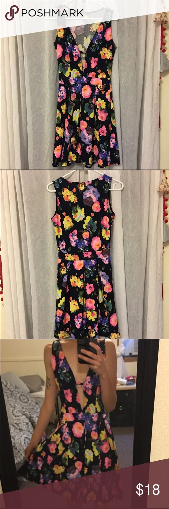 Floral Deep V Cut Out dress boohoo petite pleated Adorable dress with front cut out, pink yellow orange blue and purple flowers! From boohoo petite US size 4 UK 8. Only worn once excellent used condition. Cut out could easily be pinned for a more modest look. Approximately 34.5 inches from shoulder. The fabric had stretch and is beautifully textured! 💚 Boohoo Petite Dresses