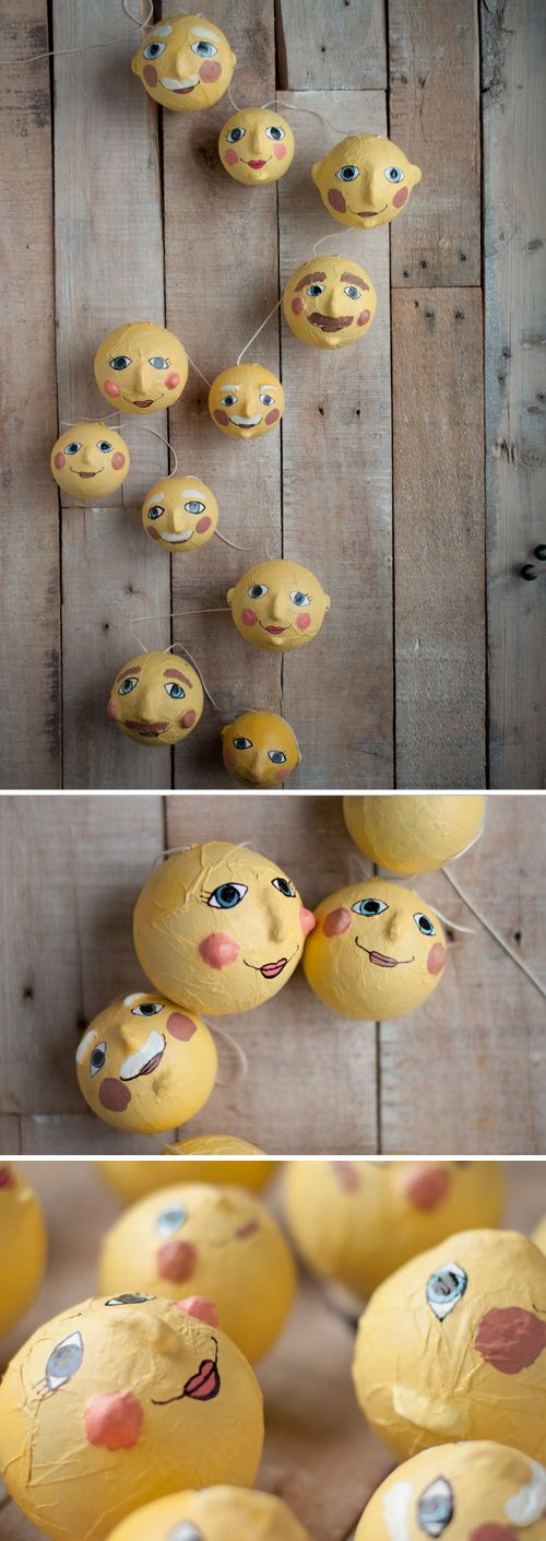 DIY: Man in the Moon Garland. So sweet in a nursery!  Easy tutorial — use air dry clay to add cheeks, chins, noses, etc. to papier maché balls. Then paint them up.   |   Design Mom