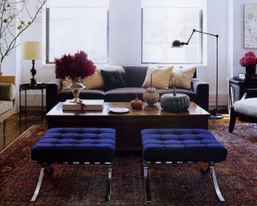 COLOR. The living room sofa was inspired by a Jean-Michel Frank design