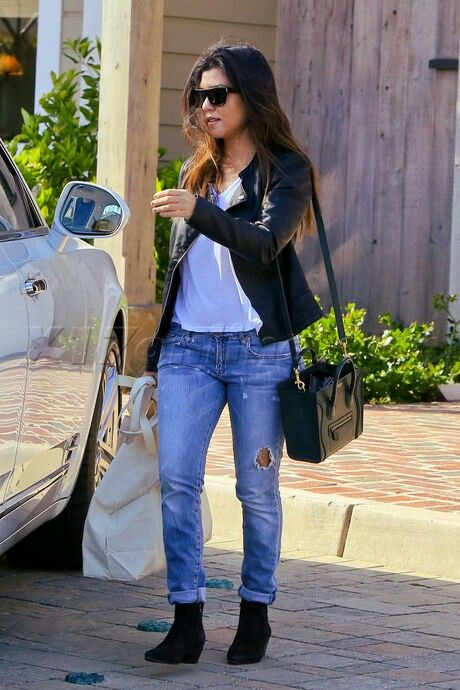 014070fa24e Kourtney Kardashian looks gab in a black biker jacket