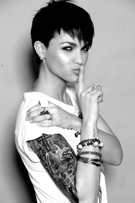 I have the hugest crush on her, but, in general, with girls who have short hair, tattoos, and piercings. #:)